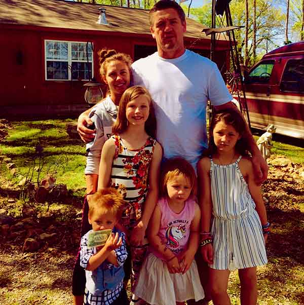 Image of JJ Da Boss with wife and children