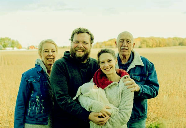Image of Charles Pol with wife, daughter, and parents