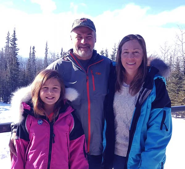 Image of Dr. Michelle Oakley with husband and daughter Willow.